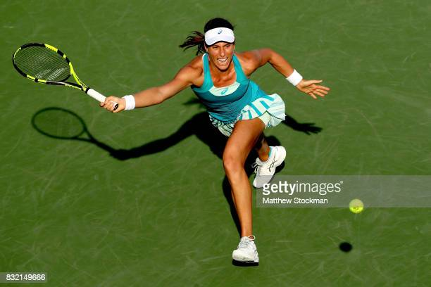 Johanna Konta of Great Britain returns a shot toKiki Bertens of Neherlands during day 4 of the Western Southern Open at the Lindner Family Tennis...