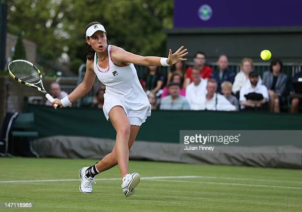 Johanna Konta of Great Britain returns the ball during her ladies' singles first round match against Christina McHale of USA on day one of the...