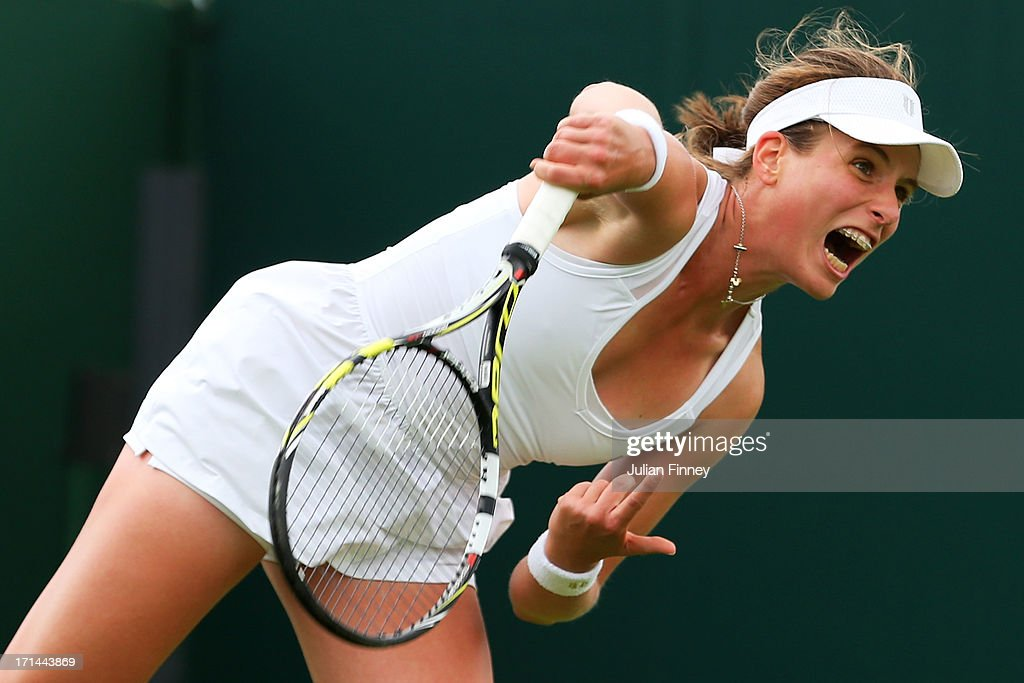 Johanna Konta of Great Britain serves during her Ladies' Singles first round match against Jelena Jankovic of Serbia on day one of the Wimbledon Lawn Tennis Championships at the All England Lawn Tennis and Croquet Club on June 24, 2013 in London, England.