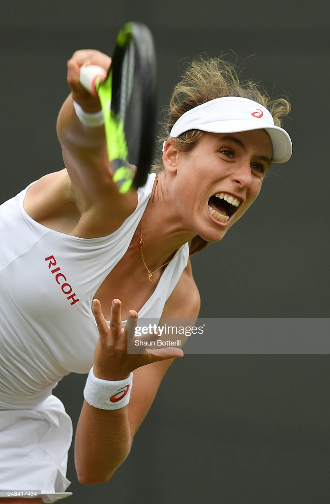 <a gi-track='captionPersonalityLinkClicked' href=/galleries/search?phrase=Johanna+Konta&family=editorial&specificpeople=4482643 ng-click='$event.stopPropagation()'>Johanna Konta</a> of Great Britain serves during the Ladies Singles first round match against Monica Puig of Puerto Rico on day two of the Wimbledon Lawn Tennis Championships at the All England Lawn Tennis and Croquet Club on June 28, 2016 in London, England.