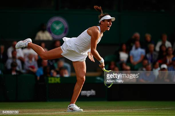 Johanna Konta of Great Britain serves during the Ladies Singles second round match against Eugenie Bouchard of Canada on day four of the Wimbledon...