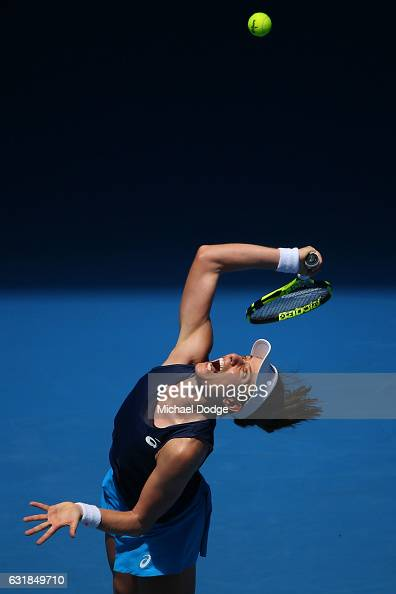 Johanna Konta of Great Britain serves in her first round match against Kirsten Flipkens of Belgium on day two of the 2017 Australian Open at...