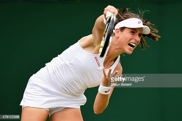 Johanna Konta of Great Britain serves in her Ladies Doubles First Round match with Marie Sanchez of the United States against Misaki Doi of Japan and...
