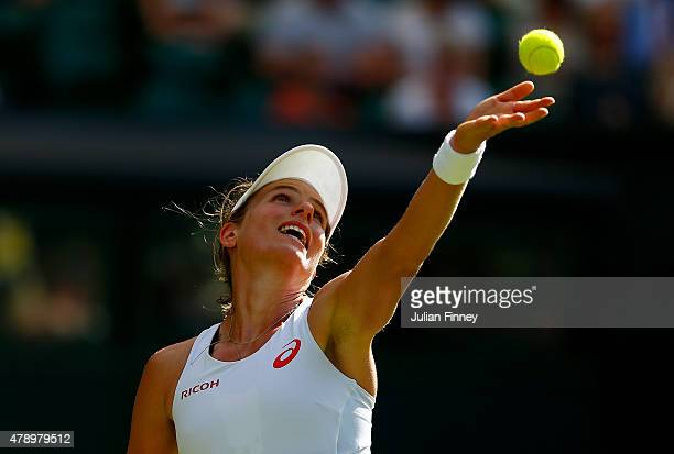 Johanna Konta of Great Britain serves in her Ladies's Singles first round match against Maria Sharapova of Russia during day one of the Wimbledon...