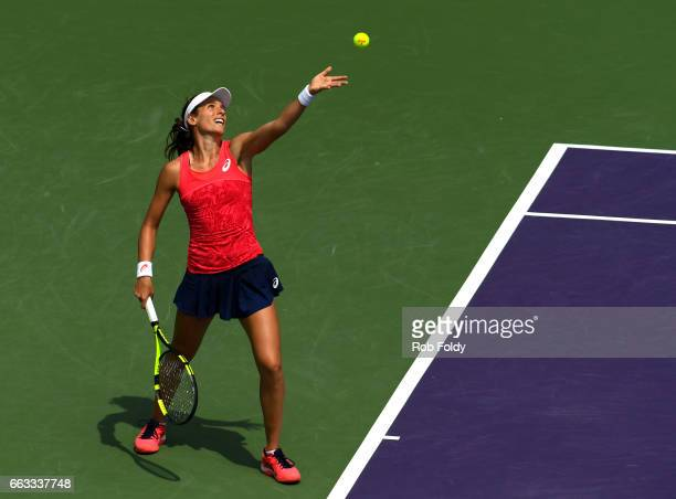 Johanna Konta of Great Britain serves in the final match against Caroline Wozniacki of Denmark on day 13 of the Miami Open at the Crandon Park Tennis...