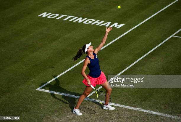 Johanna Konta of Great Britain serves partnering Yanina Wickmayer of Belgium during their Women's doubles first round match against ChiaJung Chuang...