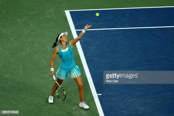Johanna Konta of Great Britain serves to Simona Halep of Romania during Day 7 of the Western and Southern Open at the Linder Family Tennis Center on...