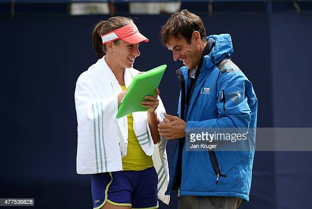 Johanna Konta of Great Britain shaes a joke with coach Jose Manuel Garca on day four of the Aegon Classic at Edgbaston Priory Club on June 18 2015 in...