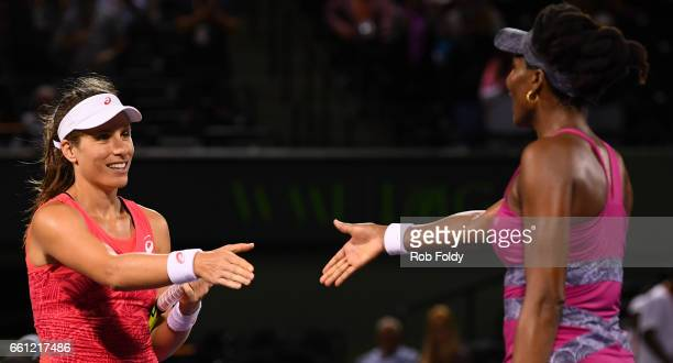 Johanna Konta of Great Britain shakes hands with Venus Williams after winning the semifinals match on day 11 of the Miami Open at the Crandon Park...