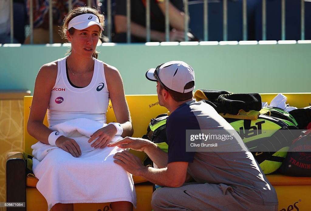 <a gi-track='captionPersonalityLinkClicked' href=/galleries/search?phrase=Johanna+Konta&family=editorial&specificpeople=4482643 ng-click='$event.stopPropagation()'>Johanna Konta</a> of Great Britain shows her emotions as she talks with her coach Esteban Carril just prior to withdrawing from her first round match against Caroline Garcia of France during day two of the Mutua Madrid Open tennis tournament at the Caja Magica on May 01, 2016 in Madrid,Spain