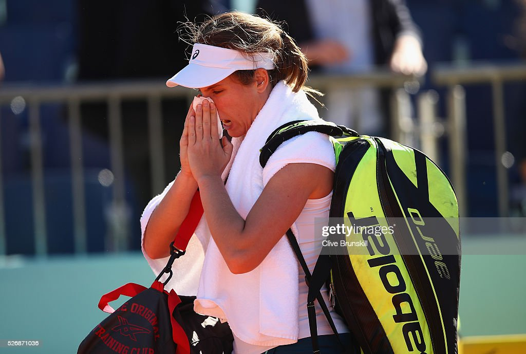 <a gi-track='captionPersonalityLinkClicked' href=/galleries/search?phrase=Johanna+Konta&family=editorial&specificpeople=4482643 ng-click='$event.stopPropagation()'>Johanna Konta</a> of Great Britain shows her emotions as she walks off the court after retiring from her first round match against Caroline Garcia of France during day two of the Mutua Madrid Open tennis tournament at the Caja Magica on May 01, 2016 in Madrid,Spain