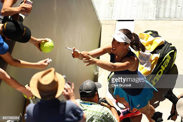 Johanna Konta of Great Britain signs autographs for fans after winning her third round match against Caroline Wozniacki of Denmark on day six of the...