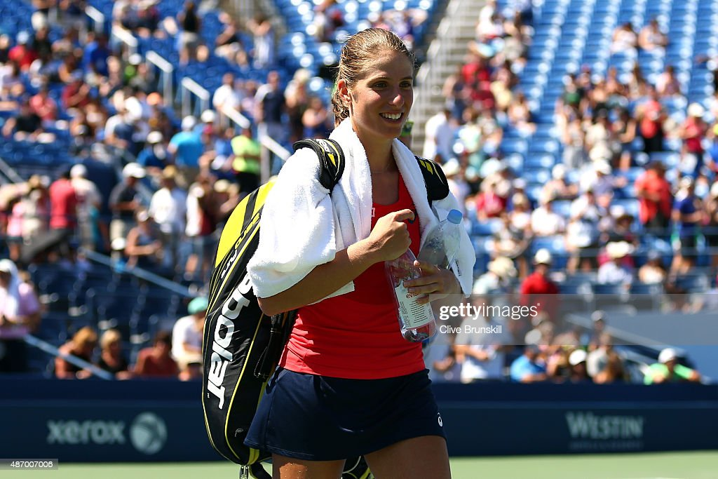 Johanna Konta of Great Britain smiles as she walks off the court after defeating Andrea Petkovic of Germany in their Women's Singles Third Round...