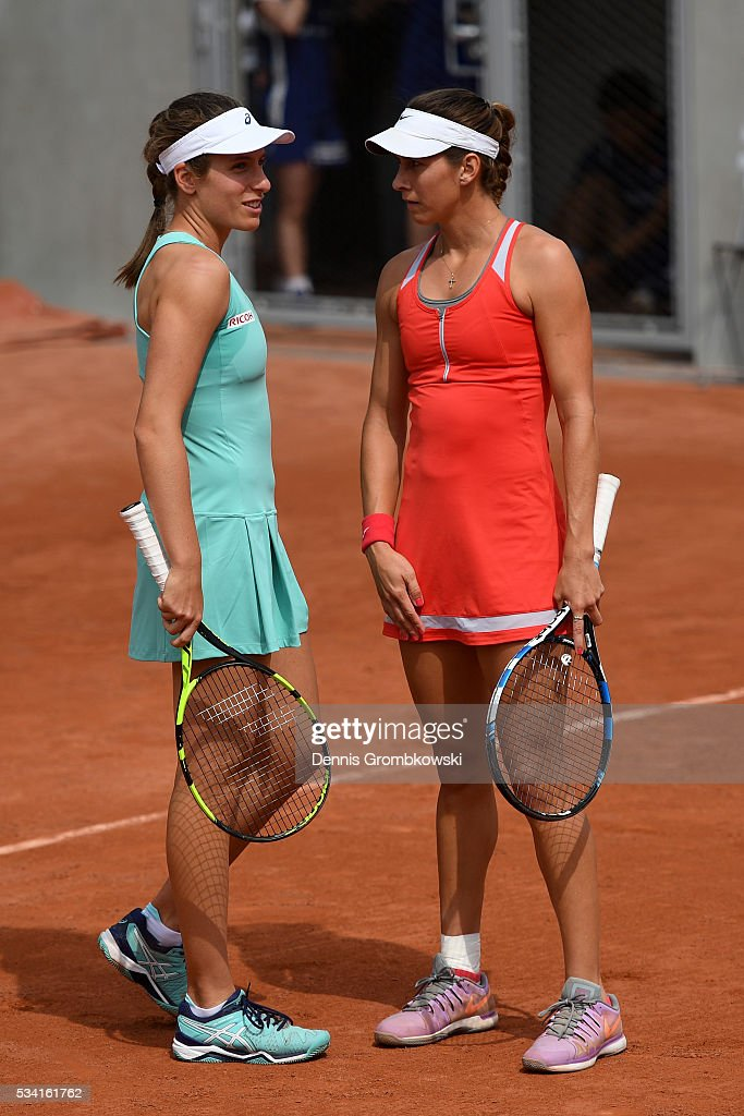 <a gi-track='captionPersonalityLinkClicked' href=/galleries/search?phrase=Johanna+Konta&family=editorial&specificpeople=4482643 ng-click='$event.stopPropagation()'>Johanna Konta</a> of Great Britain (L) talks with Maria Sanchez of the United States during the Women's Double first round match against Raquel Atawo and Abigail Spears of the United States at Roland Garros on May 25, 2016 in Paris, France.
