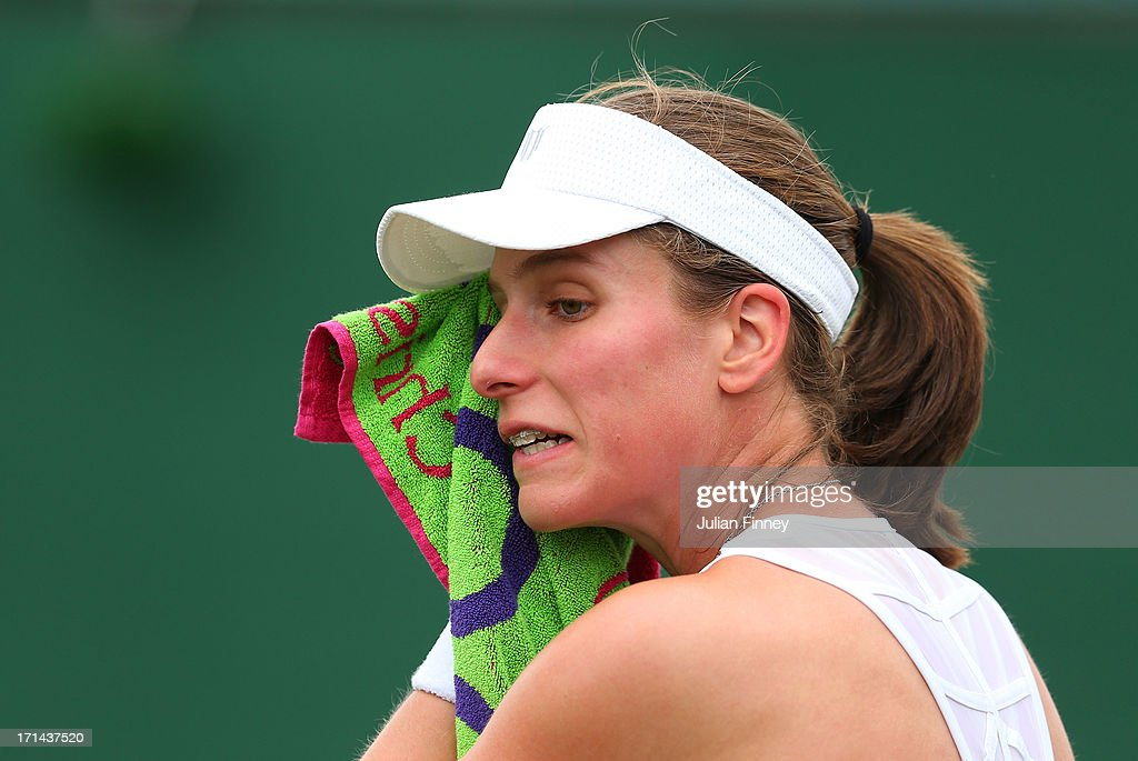 Johanna Konta of Great Britain wipes her face with a towel during a break in her Ladies' Singles first round match against Jelena Jankovic of Serbia on day one of the Wimbledon Lawn Tennis Championships at the All England Lawn Tennis and Croquet Club on June 24, 2013 in London, England.