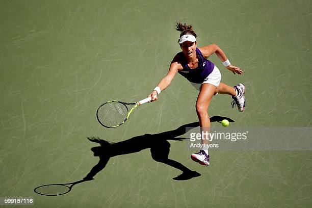Johanna Konta of the United Kingdom returns a shot to Anastasija Sevastova of Lativa during her fourth round Women's Singles match on Day Seven of...