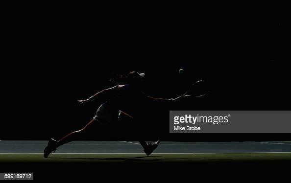 Johanna Konta of the United Kingdom returns a shot to Anastasija Sevastova of Lativa during her fourth round Women's Singles match on Day Seven of...