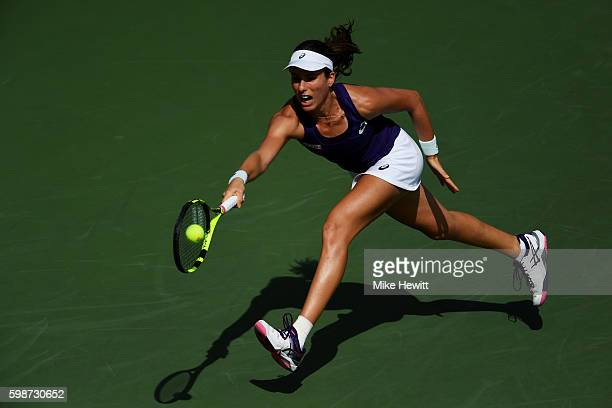 Johanna Konta of the United Kingdom returns a shot to Belinda Bencic of Switzerland during her third round Women's Singles match on Day Five of the...