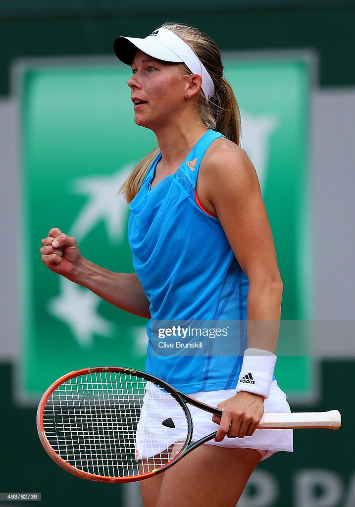 Johanna Larsson of Sweden celebrates a point during her women's singles match against Maria Kirilenko of Russia on day one of the French Open at Roland Garros on May 25, 2014 in Paris, France.