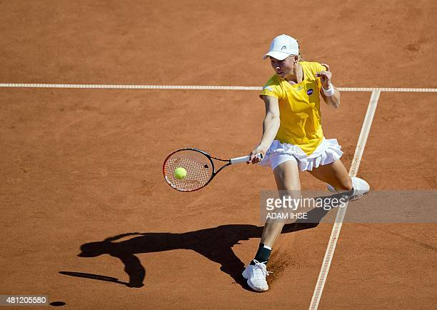 Johanna Larsson of Sweden returns a ball to Yulia Putintseva of Kazakhstan during their semi final at the WTA Swedish Open in Bastad Sweden on July...