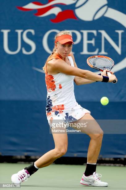 Johanna Larsson of Sweden returns a shot during her first round Women's Singles match againt Ajla Tomljanovic of Australia on Day One of the 2017 US...