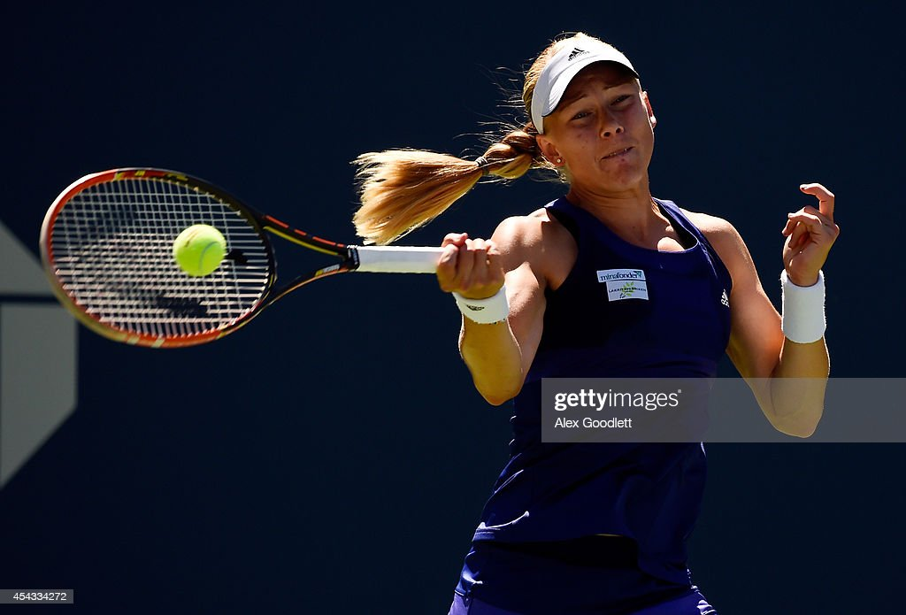 <a gi-track='captionPersonalityLinkClicked' href=/galleries/search?phrase=Johanna+Larsson&family=editorial&specificpeople=6727077 ng-click='$event.stopPropagation()'>Johanna Larsson</a> of Sweden returns a shot to Jelena Jankovic of Serbia during her women's singles third round match on Day Five of the 2014 US Open at the USTA Billie Jean King National Tennis Center on August 29, 2014 in the Flushing neighborhood of the Queens borough of New York City.