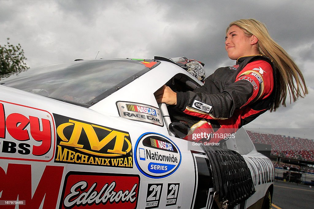 Johanna Long, driver of the #70 ForeTravel Chevrolet, climbs out of her car during qualifying of the NASCAR Nationwide Series Aaron's 312 at Talladega Superspeedway on May 3, 2013 in Talladega, Alabama.