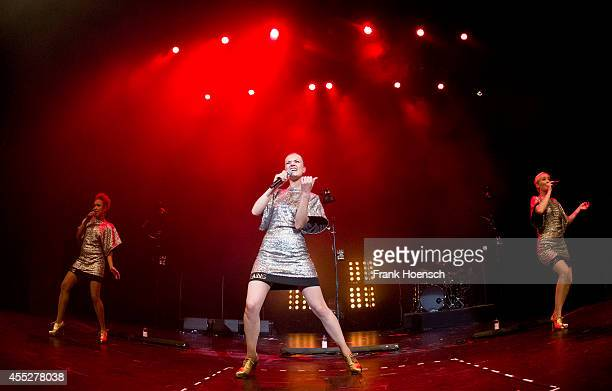 Johanna Marshall Nicola Rost and Larissa Pesch of the German band Laing perform live during a concert at the Volksbuehne on September 11 2014 in...