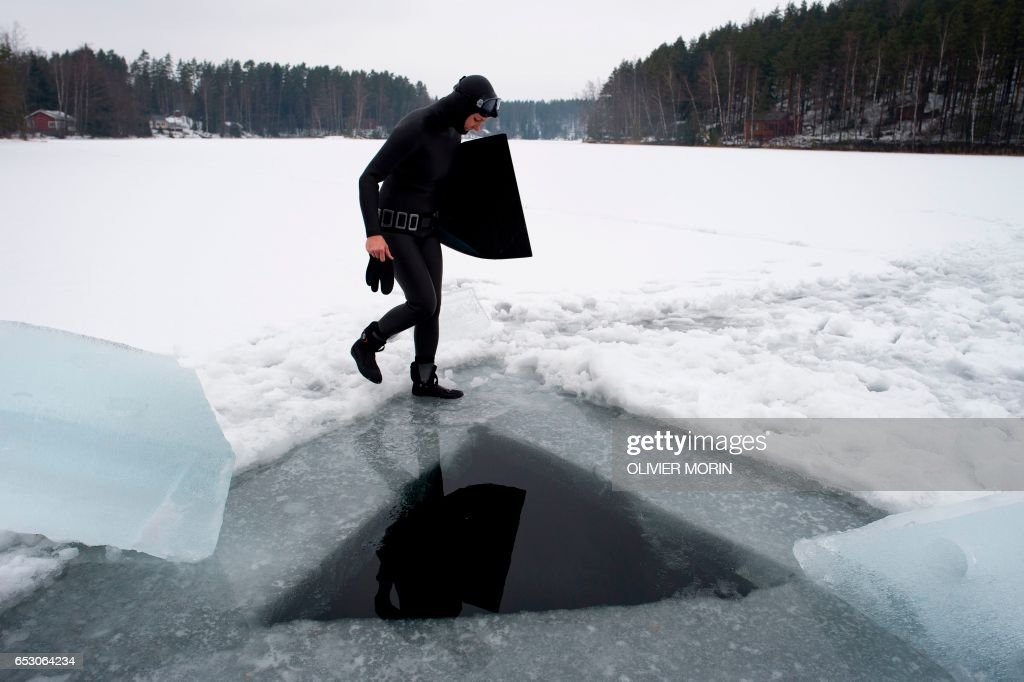 Johanna Nordblad, 42, Finnish freediver makes her way to the hole in order to train Ice-freediving training session on February 28, 2017, in Somero (southwest Finland)