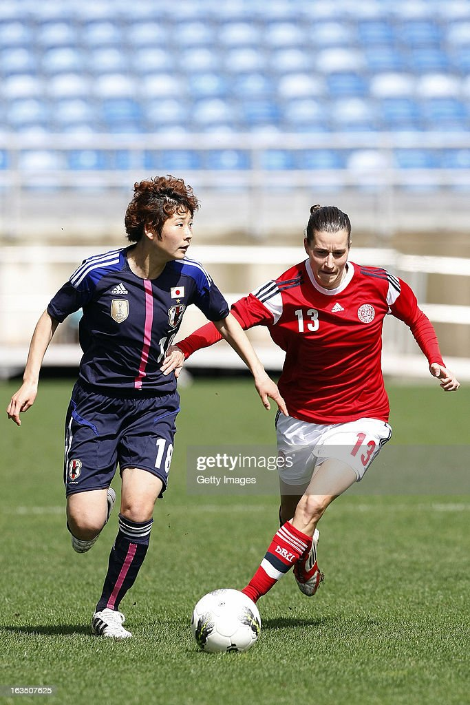 Johanna Rasmussen of Denmark challenges Yuka Kado of Japan during the Algarve Cup 2013 match between Denmark and Japan at the Algarve stadium on March 11, 2013 in Faro, Portugal.