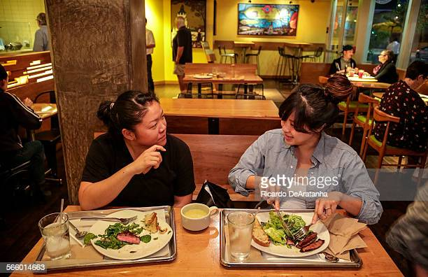 Johanna Tchon Lt from Hacienda Heights and friend Jane Moro from Silver Lake eating Flatiron/Backyard steak at Tender Greens in Pasadena Thursday...