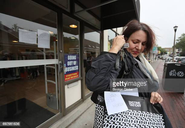 Johanna Wechsler of Cambridge collects a bag of her clothes from the Newton MA Second Time Around consignment shop on Jun 5 2017 She says she has...