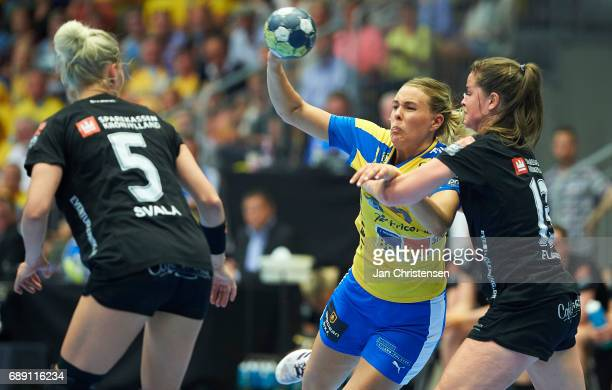 Johanna Westberg of Nykobing Falster Handbold challenge for the ball during the Primo Tours Ligaen 3 Final match between Nykobing Falster Handbold...