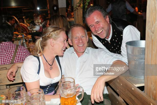 Johannes B Kerner and his sister Julia and Thomas Schreiner CEO LaurentPerrier Champagner during the Oktoberfest at Kaeferzelt at Theresienwiese on...