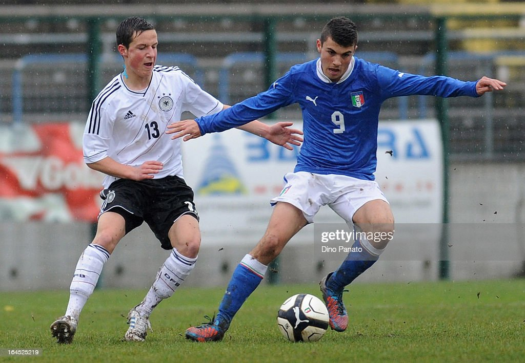 Johannes Bender (L) of Germany U15 competes with Patrick Cutrone of Italy U15 during the International U15 Tournament match between U15 Germany and U15 Italy at Stadio Tognon on March 24, 2013 in Fontanafredda, Italy.