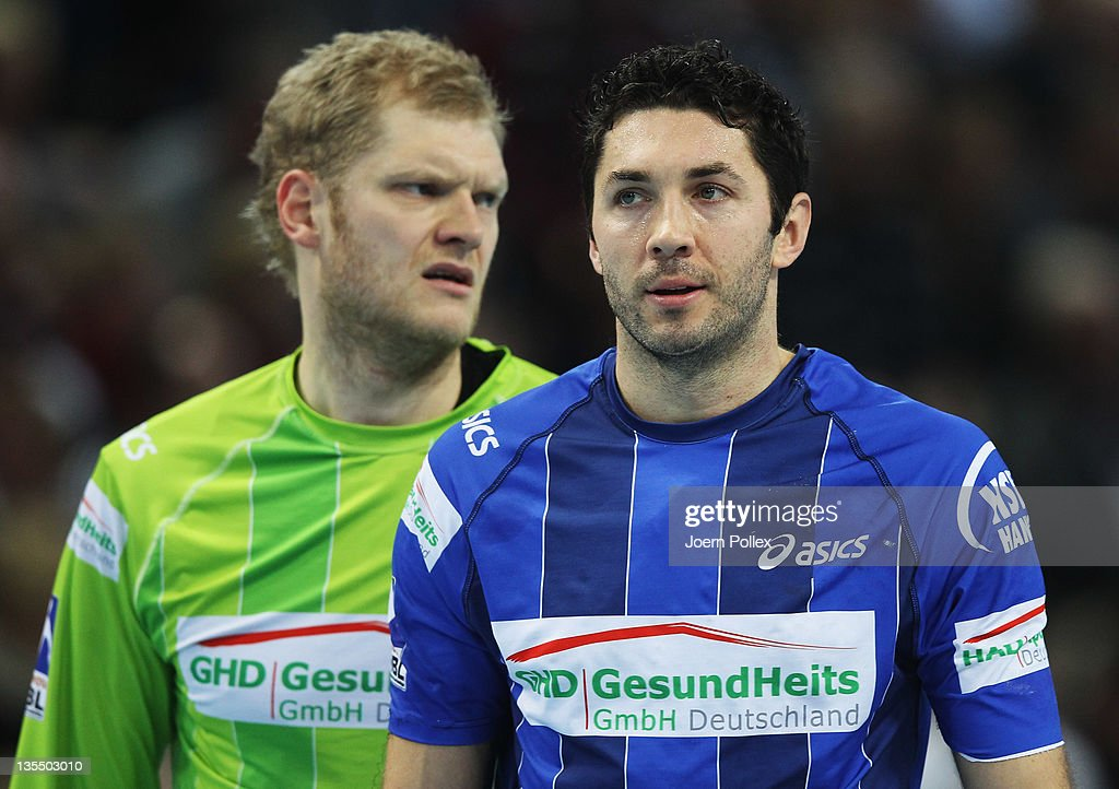 Johannes Bitter (L) and Blazenko Lackovic of Hamburg are seen after the Toyota Handball Bundesliga match between THW Kiel and HSV Hamburg at the Sparkassen Arena on December 11, 2011 in Flensburg, Germany.