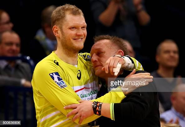 Johannes Bitter goaltender of Hamburg celebrate with head coach Michael Biegler during the DKB Bundesliga handball match between HSV Handball and...