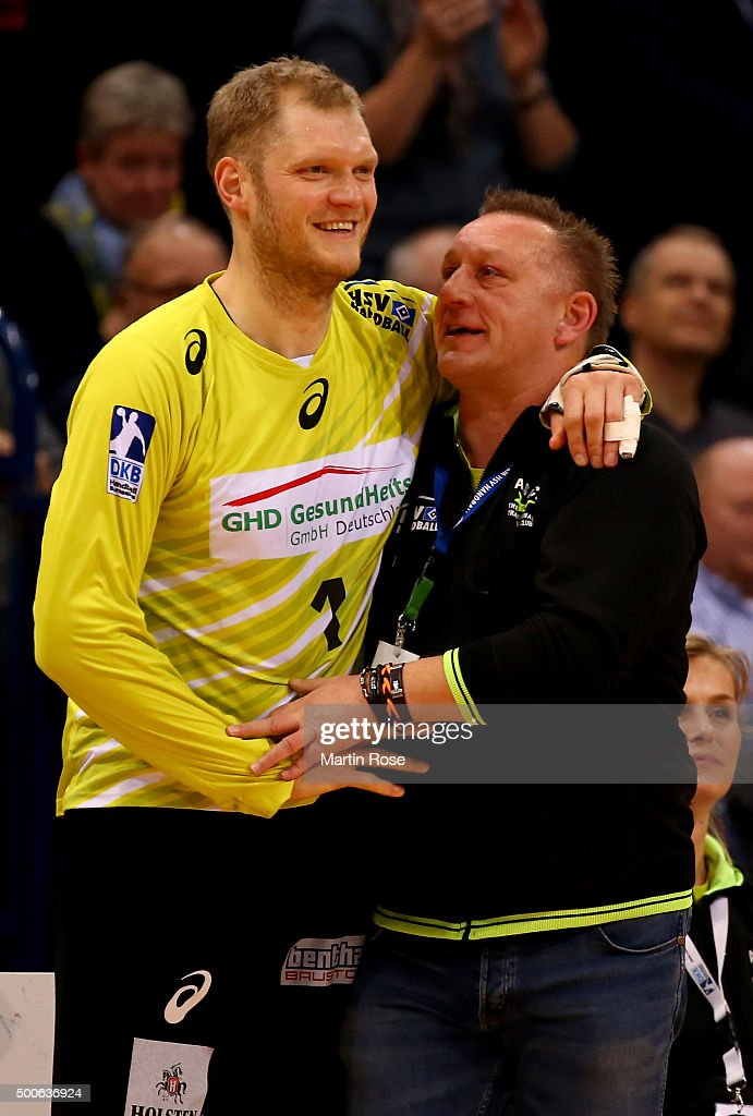 Johannes Bitter goaltender of Hamburg celebrate with head coach Michael Biegler during the DKB Bundesliga handball match between HSV Handball and...