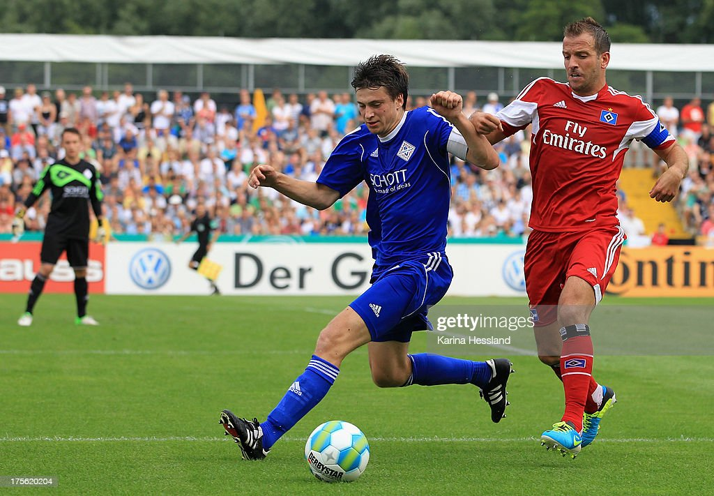 Johannes Carl of Jena and Rafael van der Vaart of Hamburg battle for the ball during the DFB Cup between SV Schott Jena and Hamburger SV at Ernst-Abbe-Sportfeld on August 04, 2013 in Jena,Germany.