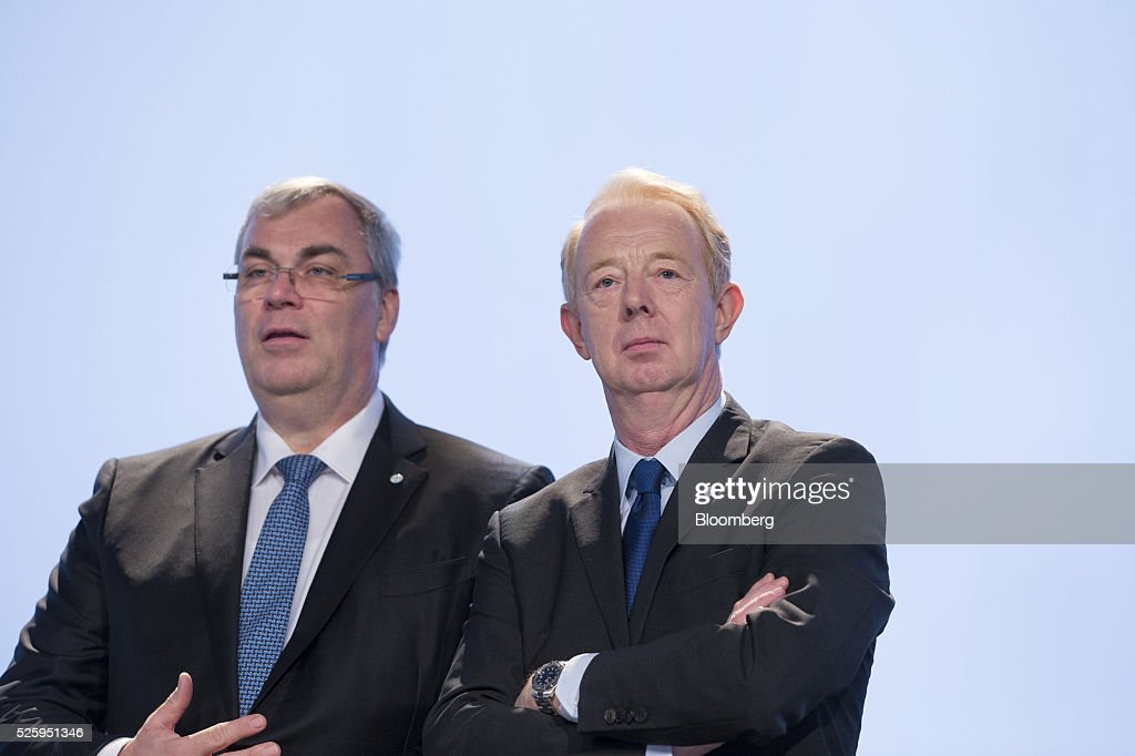 Johannes Dietsch, chief financial officer of Bayer AG, left, and Marijn Dekkers, outgoing chief executive officer of Bayer AG, pose for a photograph ahead of the drugmaker's annual general meeting in Cologne, Germany, on Friday, April 29, 2016. Bayer, Germany's largest company, reported first-quarter profit that beat analysts' estimates as top-selling drugs Xarelto and Eylea continued to soar. Photographer: Martin Leissl/Bloomberg via Getty Images