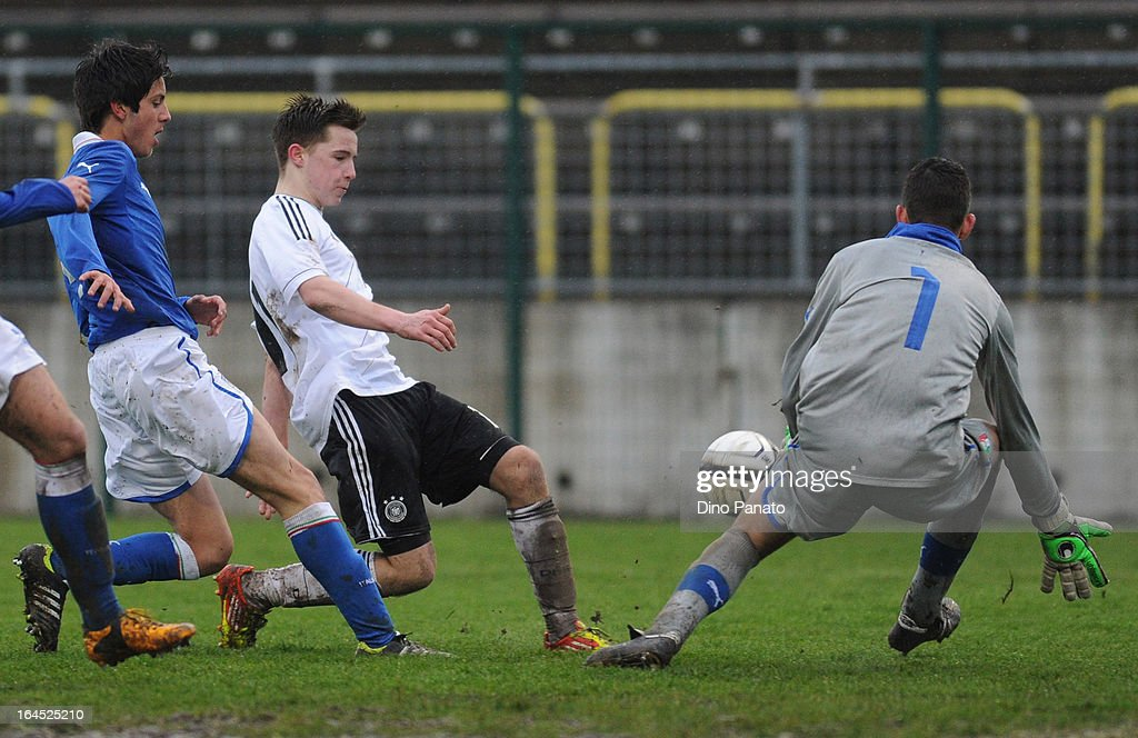 Johannes Eggestein (C) Germany U15 competes with Luca Crosta goalkeeper of Italy U15 during the International U15 Tournament match between U15 Germany and U15 Italy at Stadio Tognon on March 24, 2013 in Fontanafredda, Italy.