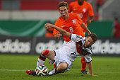 Johannes Eggestein of Germany challenges Carel Eiting of Netherlands during the KOMM MIT tournament match between U17 Germany and U17 Netherlands at...