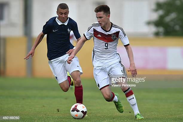 Johannes Eggestein of Germany is challenged by Hugo Mesbah of France during the International Friendly match between U16 France and U16 Germany at...