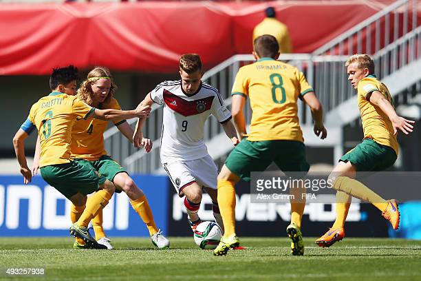 Johannes Eggestein of Germany is challenged by Joe Caletti Kye Rowles Jake Brimmer and Joshua Laws of Australia during the FIFA U17 World Cup Chile...