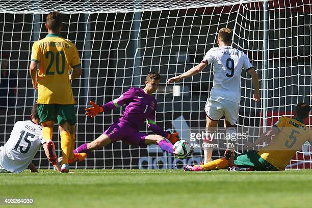 Johannes Eggestein of Germany scores his team's second goal against goalkeeper Duro Dragicevic of Australia during the FIFA U17 World Cup Chile 2015...