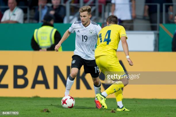 Johannes Eggestein of Germany und Idriz Voca of Kosovo battle for the ball during the U21 UEFA 2018 EM Qualifying match between Germany and Kosovo at...