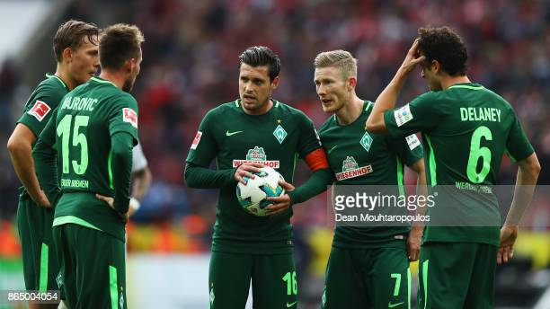 Johannes Eggestein Zlatko Junuzovic Izet Hajrovic Florian Kainz and Thomas Delaney of Werder Bremen speak before taking a free kick during the...