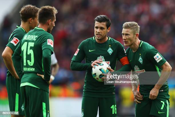 Johannes Eggestein Zlatko Junuzovic Izet Hajrovic Florian Kainz of Werder Bremen speak before taking a free kick during the Bundesliga match between...
