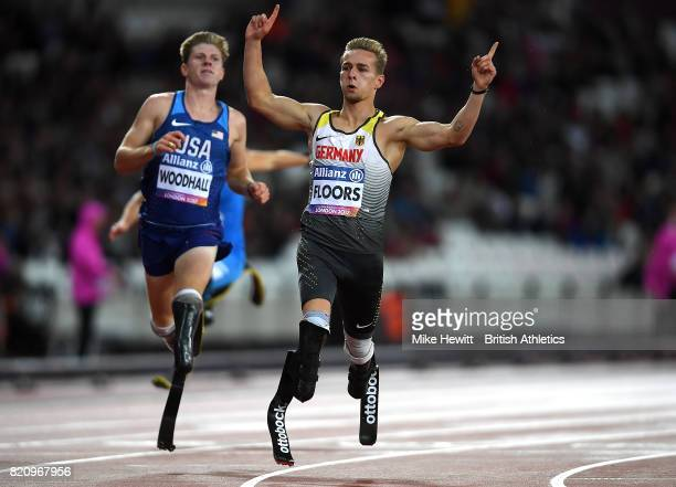Johannes Floors of Germany celebrates after winning gold in the final of the mens 200m T43 during day nine of the IPC World ParaAthletics...