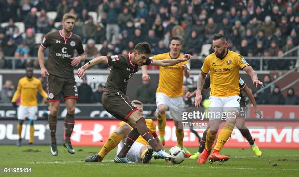 Johannes Flum of St Pauli and Marco Hartmann of Dynamo Dresden and Giuliano Modica of Dynamo Dresden battle for the ball during the Second Bundesliga...